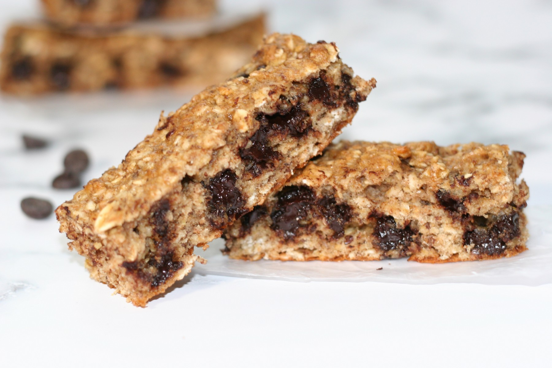Two breakfast bars on a white counter top