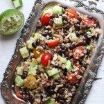 Close-up shot of the moroccan-spiced black bean salad on a antique silver platter