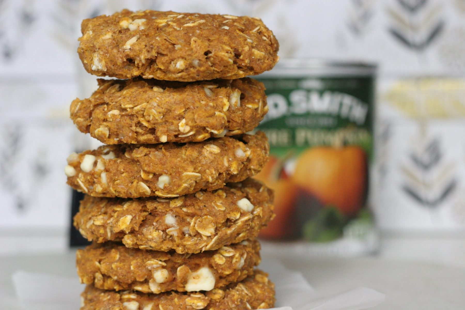 Stack of kid friendly pumpkin scones on parchment paper