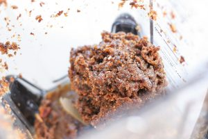 Mixture of prunes, almond butter and honey after blending in the Ninja blender