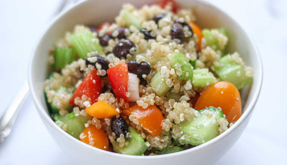 Close up for healthy Easy Quinoa Salad with Feta in a small white bowl