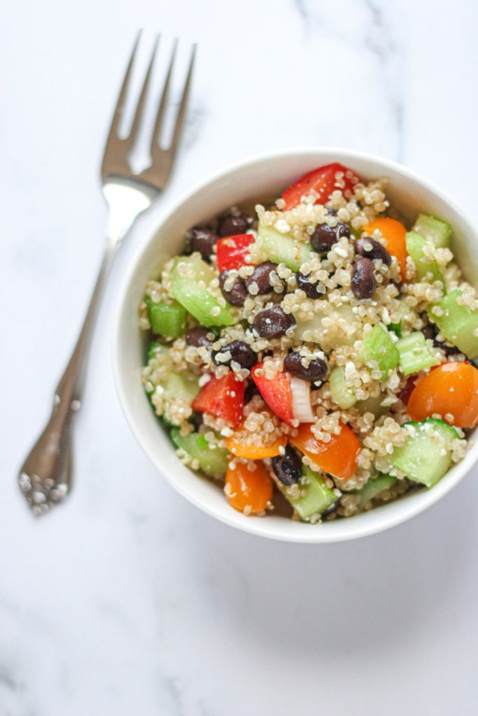 Close up shot of Easy Quinoa Salad with Feta on a white background