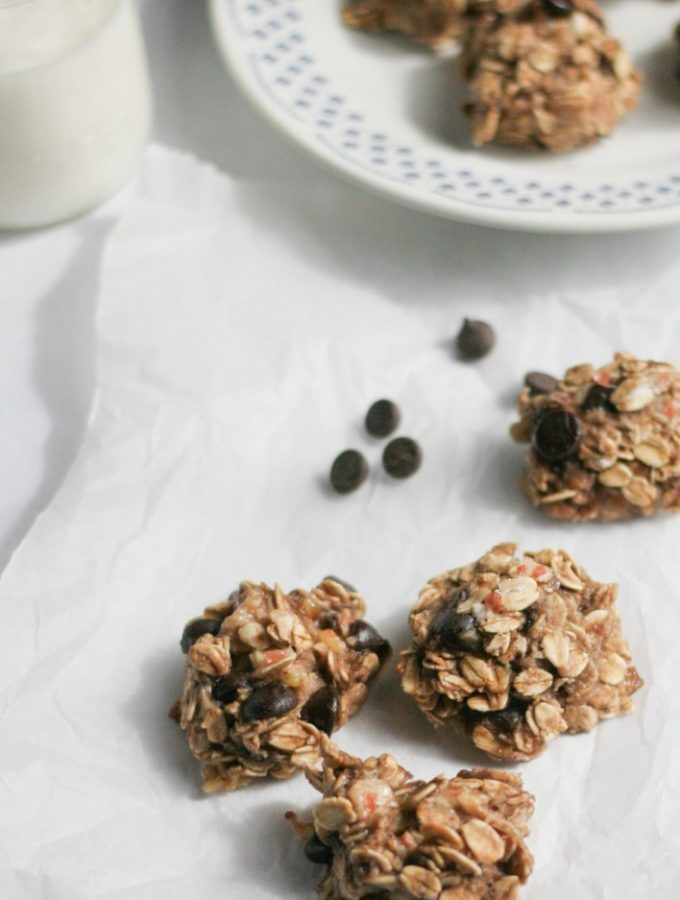 Healthy 3-Ingredient Sweet and Salty Oat Cookies on a white table with a glass of milk
