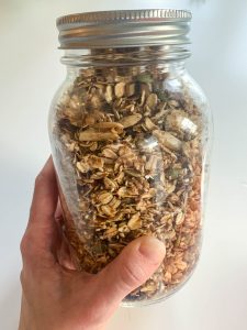 A large mason jar filled with healthy granola