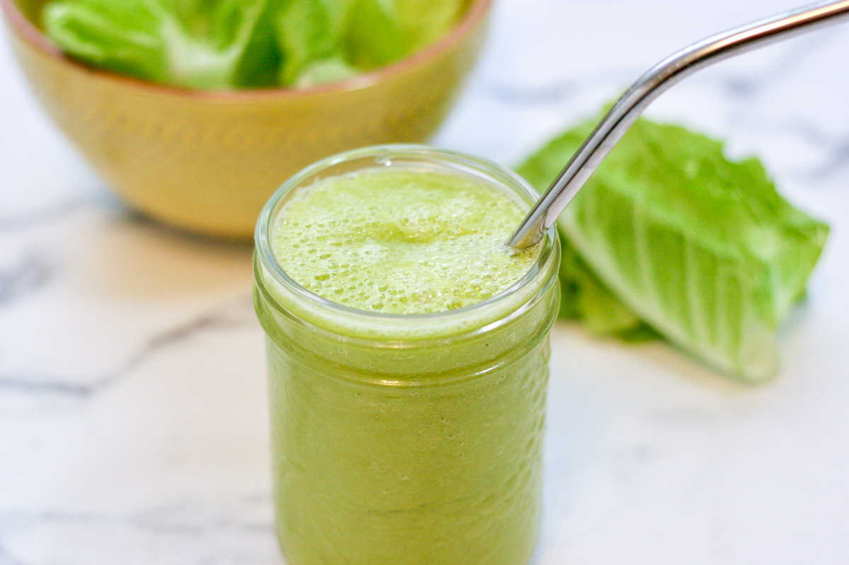 A small mason jar of 4 Ingredient Green Smoothie on a white countertop
