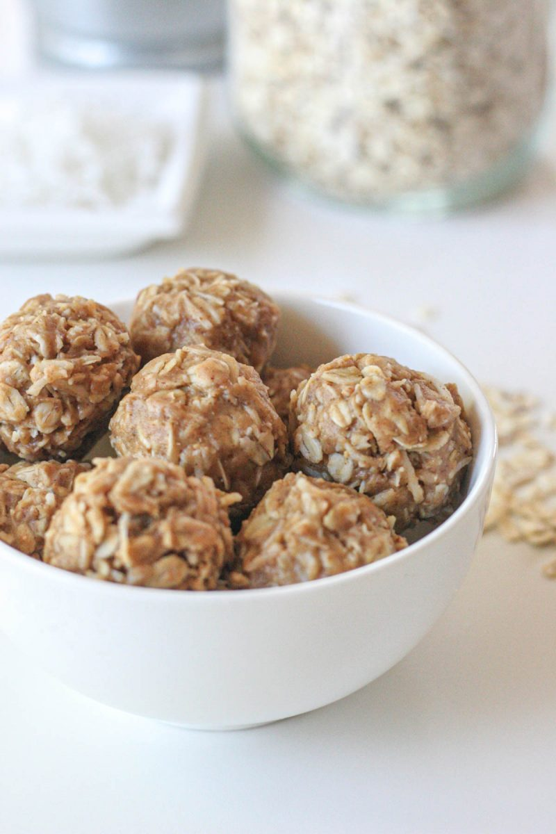 A small white bowl of energy bites made with coconut and peanut butter