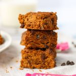 A stack of Gluten-Free Black Bean Brownies with Date Sugar on a white tablecloth