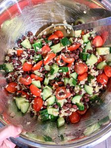 Bowl of mixed cucumbers, tomatoes, cucumber and black beans