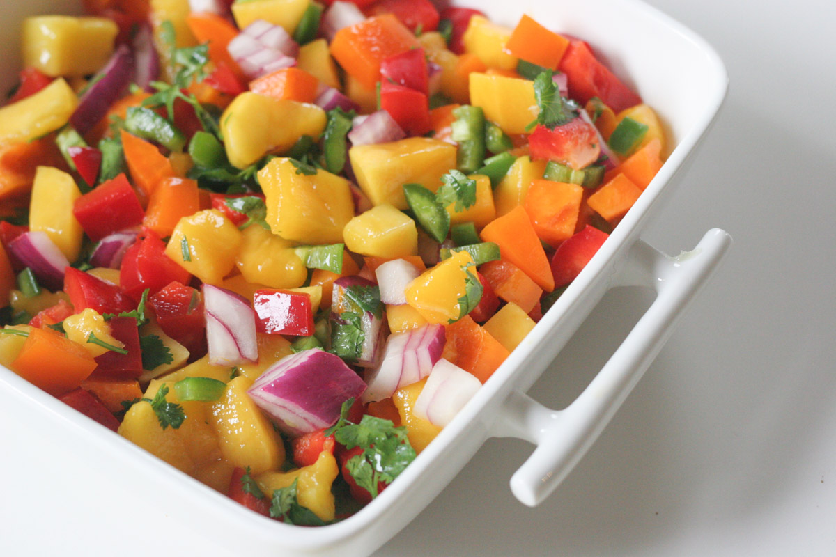 Close up of Simple Mango Salsa in a white square dish