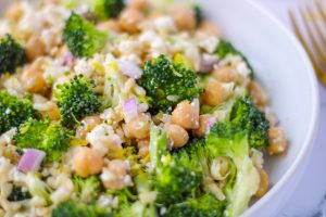 Close up of a white dish filled with Brown Rice, Broccoli and Feta Salad