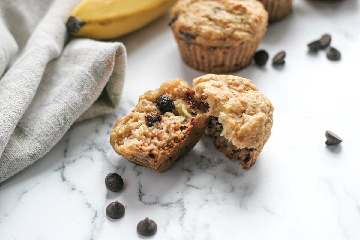 Close up shot of Best Ever Banana Chocolate Chip Muffins cut in half