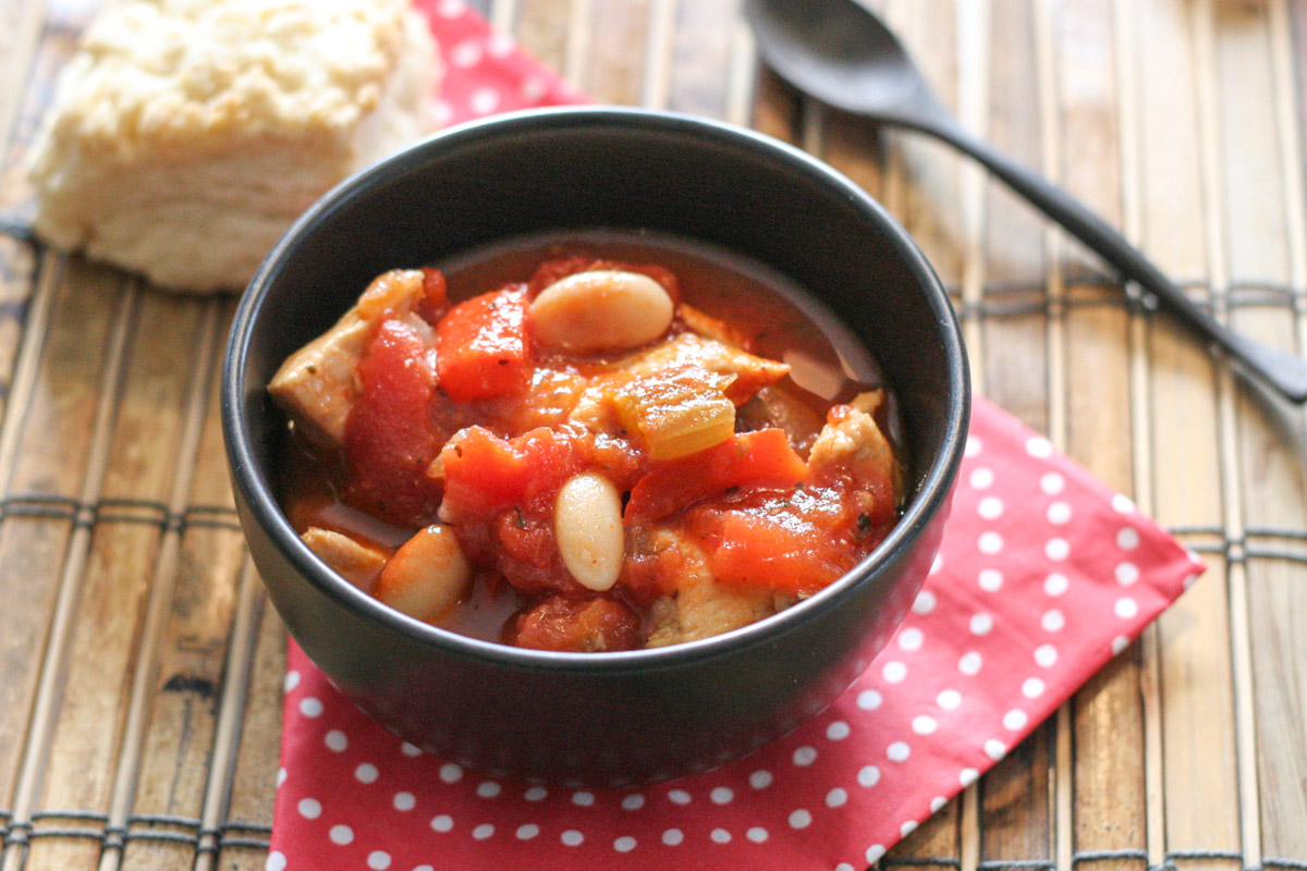 Easy Chicken Soup with Tomatoes and White Beans on a polka dot napkin