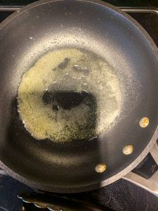 Melted butter in a small pan