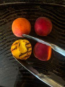 4 peach halves on a grill pan