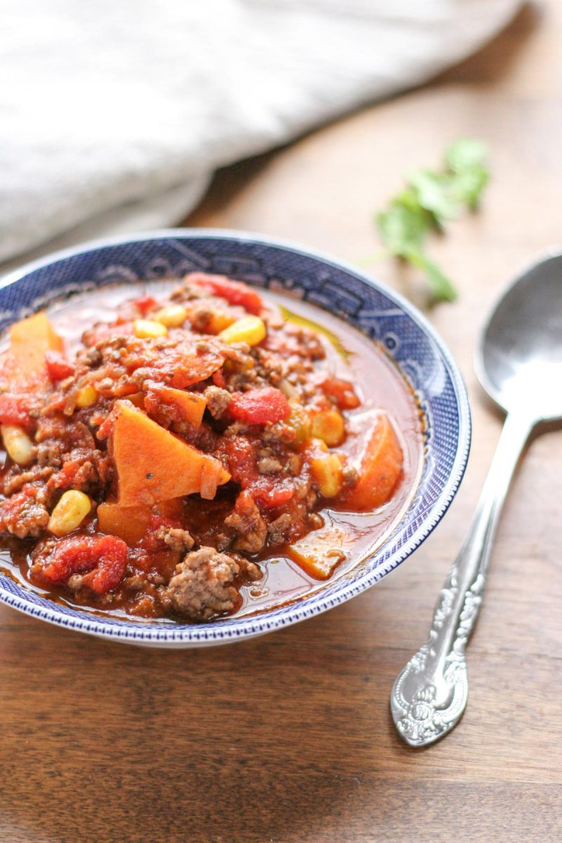 Easy Weeknight Hamburger Soup with Sweet Potatoes in a blue bowl