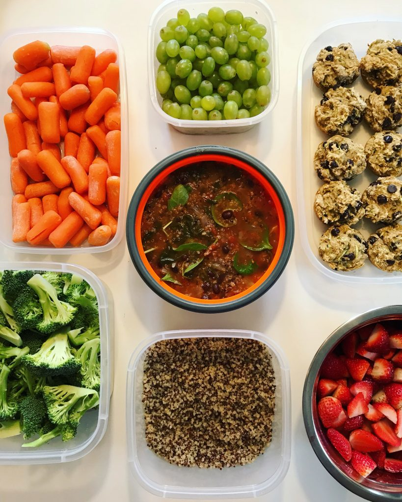 Example of food prep with carrots, muffins, grapes, soup and chopped vegetables