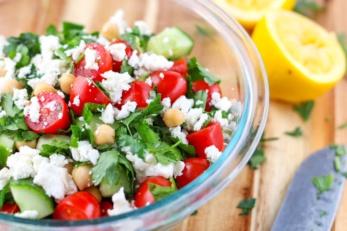 Fresh Herb Salad with Chickpeas and Feta in a clear bowl