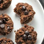 Gluten-free muffins with chocolate chips on a white plate
