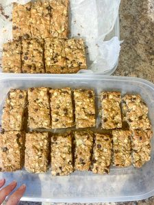 A Tupperware container filled with Gluten-Free Oatmeal Breakfast Bars with Chocolate cut into bars