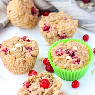 cranberry muffins on a white countertop