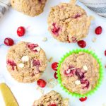 overhead shot of 4 cranberry oatmeal muffins on a white countertop
