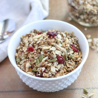 Healthy Gluten Free Granola in a white bowl on a brown table top