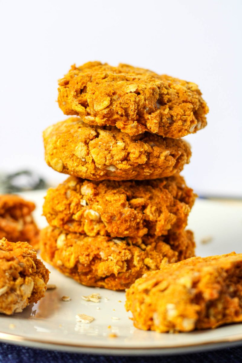 A stack of pumpkin scones on a white plate