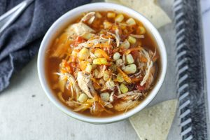 Healthy Insta Pot Chicken Tortilla Soup in a small bowl with chips on the side