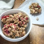 Healthy Peanut Butter Oatmeal Raspberry Breakfast Bites in a white bowl on a wood tabletop