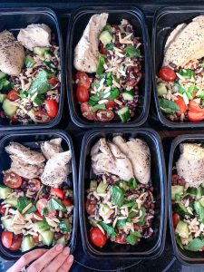 Moroccan-Spiced Black Bean Salad in black containers with chicken