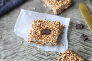 One Puffed Quinoa Bars with Almond Butter on a small piece of parchment paper