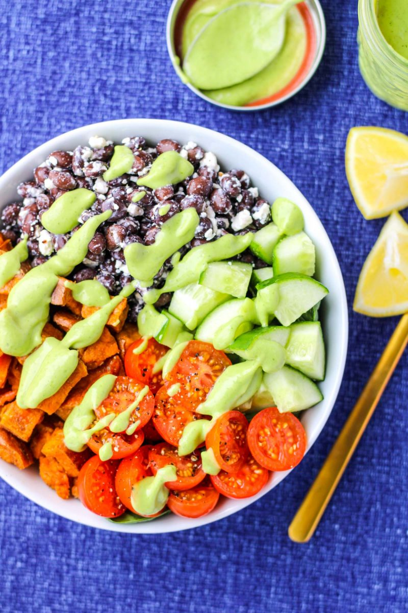 Powerhouse Veggie Bowls with Whipped Avocado Cilantro Dressing on a blue tablecloth