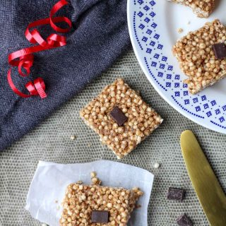 Puffed Quinoa Bars with Almond Butter on a grey placemat and a white plate