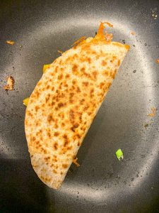 Simple Haddock Quesadilla cooking on a non-stick pan