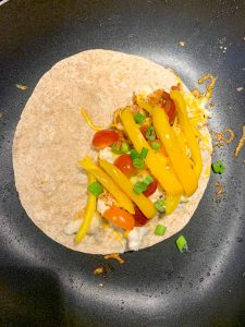 Simple Haddock Quesadilla in a pan cooking