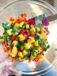 Simple Mango Salsa all mixed together in a small glass bowl
