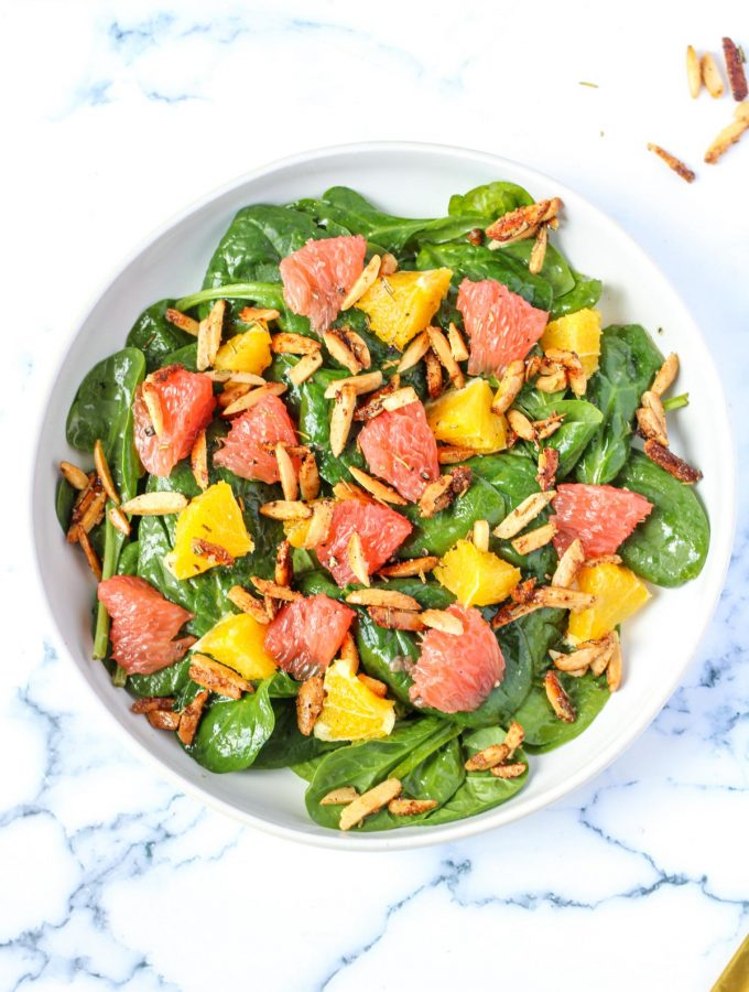 overheat shot of a spinach salad with oranges and grapefruit sections