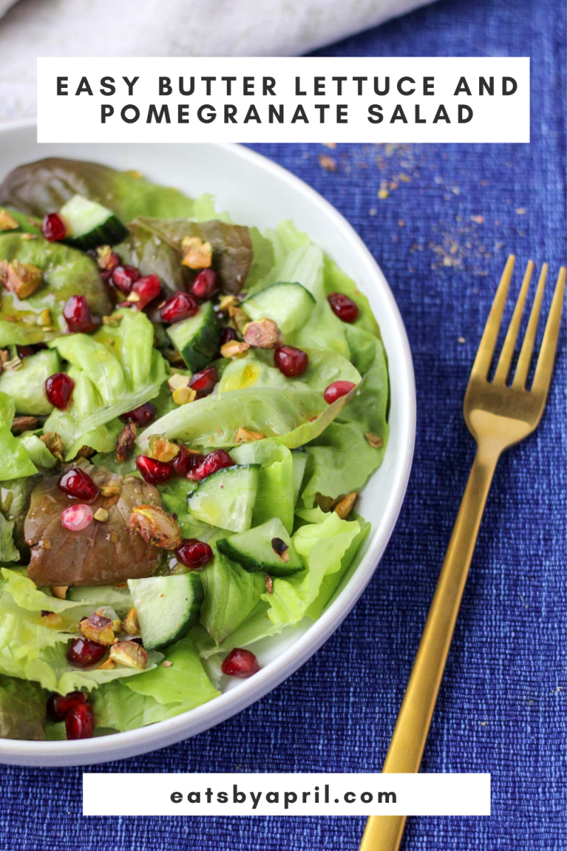 Easy Butter Lettuce and Pomegranate Salad on a blue tablecloth