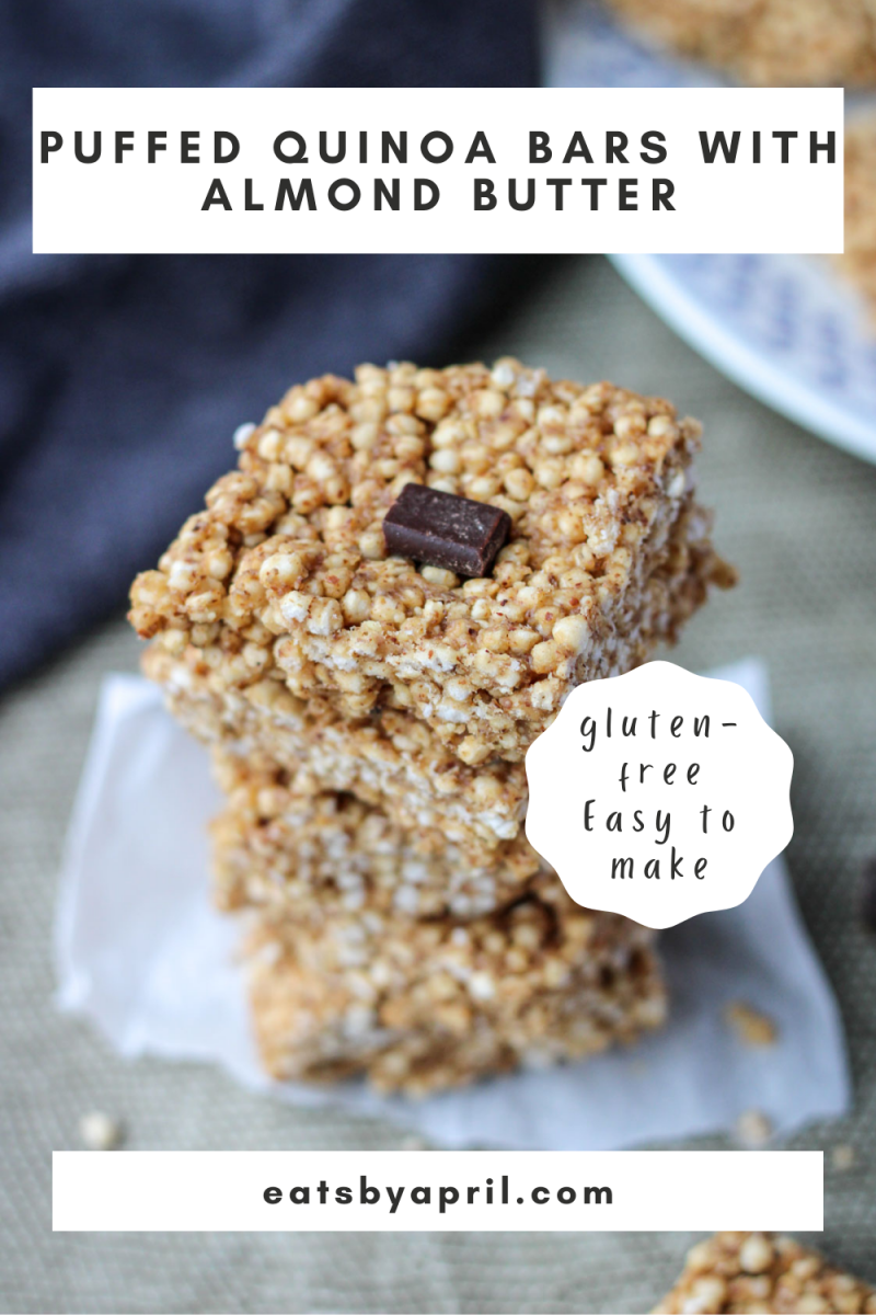 a stack of puffed quinoa squares on a dark grey placemat