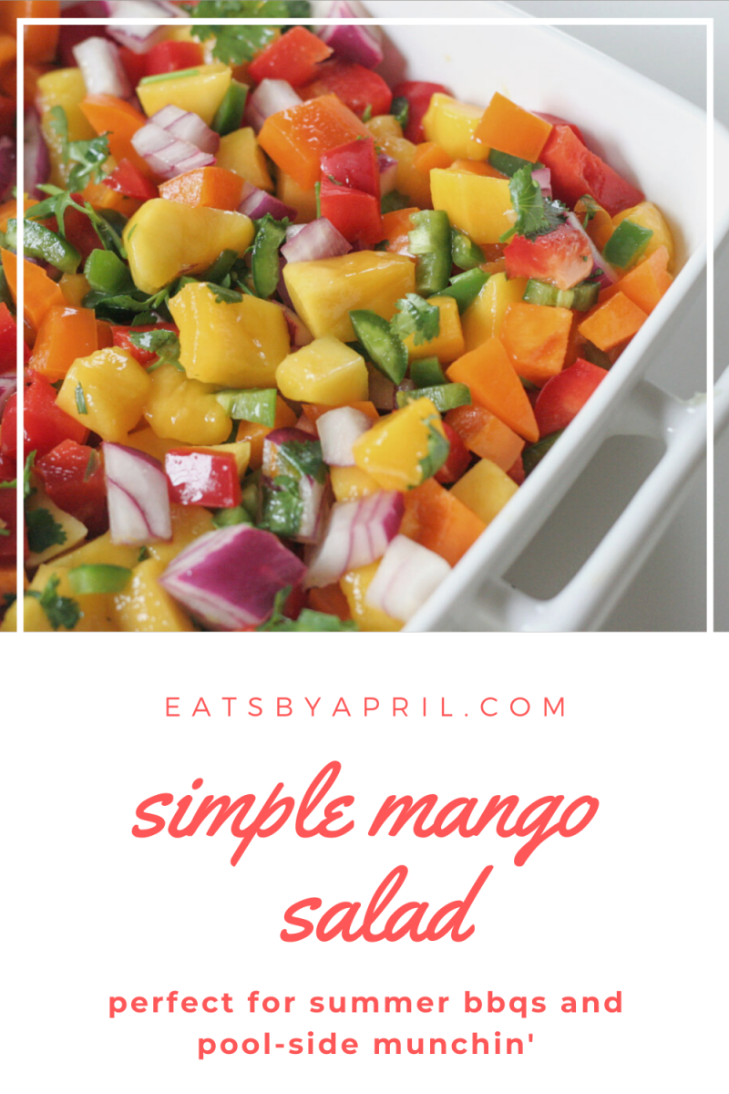 white bowl with chopped mango, peppers and red onion